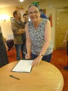 Lorraine signing the FTNCG Constitution