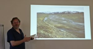 Stephen showing his photo of modern periglacial conditions near the Arctic
